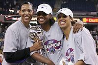 2005: Olympia Scott, Nicole Powell celebrate winning the WNBA Championships in Sacramento, CA.