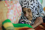 An elderly Palestinian woman sleeps as she receives treatment at El Wafa elderly nursing home, in Gaza city on Feb. 12, 2017. El Wafa elderly nursing home was established in 1980 as one of programs of Al-Wafa Charity Association. El-Wafa hospital was destroy during the 50-day war between Israel and Hamas militants in the summer of 2014 by Israeli forces. Photo by Sana'a Al-Ajez