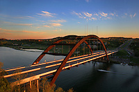 Beautiful afternoon Sunset at the 360 Bridge (Pennybacker Bridge) surrounding hills and lake austin, Texas, USA