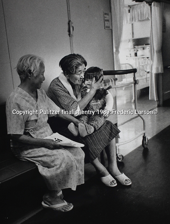 Resident of the Hiroshima A-bomb nursing home care for dolls as if they were the children they lost during the war. .Pulitzer finalist entry 1989 Frederic Larson©