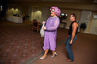 Dame Edna and Arnold Schwarzenegger impersonators play about during the Sunburst.Convention of Professional Tribute Artists