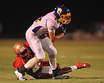 Oxford High's Toler Presley (14) is tackled by Lafayette High's Jeremiah Jones (26) at William L. Buford Stadium in Oxford, Miss. on Friday, September 2, 2011. Lafayette won 40-12