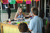 HOT SPRINGS, AR - MARCH 18: Horse racing spectators purchase programs and cheat sheets before the running of the Rebel Stakes at Oaklawn Park on March 18, 2017 in Hot Springs, Arkansas. (Photo by Justin Manning/Eclipse Sportswire/Getty Images)