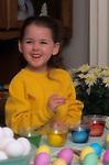 Child coloring eggs for kid's Easter Egg hunt