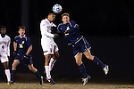 24 November 2013: Wake Forest's Jacori Hayes (8) and Navy's Grant Valenstein (right). The Wake Forest University Demon Deacons played the Naval Academy Midshipmen at Spry Stadium in Winston-Salem, NC in a 2013 NCAA Division I Men's Soccer Tournament Second Round match. Wake Forest won the game 2-1.