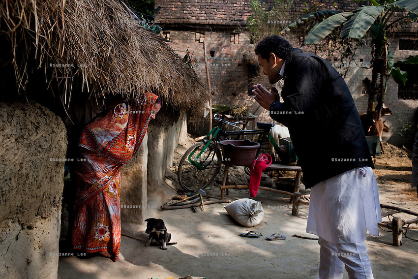 """Minister of Legislative Assembly, Ritesh Pandey, 30, campaigns door-to-door in a Dalit (the lowest Hindu caste) village with a crowd of supporters chanting slogans such as """"long live Ritesh Pandey"""" and """"press the button, decide the elephant (symbol)"""" in Ajanpara, Ambedkar Nagar, Uttar Pradesh, India, on 21st January, 2012. Returning 1.5 years ago after almost 10 years abroad, Pandey is contesting on behalf of the Bahujan Samaj Party (BSP), a party that is based on its appeal to Dalit voters. Party leader Mayawati, herself a Dalit, has recently been giving out more tickets to muslims and high caste candidates in an attempt to woo a larger spectrum of voters in Uttar Pradesh, a Bellwether state. Photo by Suzanne Lee for The National (online byline: Photo by Szu for The National)"""
