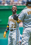 21 June 2015: Pittsburgh Pirates outfielder Andrew McCutchen hands his batting helmet back to the batboy during play against the Washington Nationals at Nationals Park in Washington, DC. The Nationals defeated the Pirates 9-2 to sweep their 3-game weekend series, and improve their record to 37-33. Mandatory Credit: Ed Wolfstein Photo *** RAW (NEF) Image File Available ***