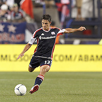 New England Revolution midfielder Ryan Guy (13) passes the ball. In a Major League Soccer (MLS) match, Montreal Impact defeated the New England Revolution, 1-0, at Gillette Stadium on August 12, 2012.