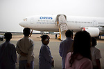 Patients wait to board the ORBIS Flying Eye Hospital for surgeries. The DC-10 aircraft is equipped with a examination, operating and recovery rooms.  In addition, a theater broadcasts the ongoing surgeries so that local doctors can watch and ask questions to the surgeons. Photo taken Wednesday, April 15, 2008.  Kevin German /  kevin@kevingerman.com..ORBIS Flying Eye Hospital brought doctors, nurses and specialists from all over the world to Ho Chi Minh City, Vietnam from April 7-18, 2008.  The ORBIS program contributed to the efforts of Ho Chi Minh City Eye Hospital in fighting avoidable blindness by educating local ophthalmologists to diagnose and manage pediatric blindness, retinal disease, oculoplastics, and blindness due to glaucoma..