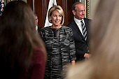 Betsy DeVos, United States Secretary of Education, arrives with her husband Dick DeVos Jr., right, to be sworn in by U.S. Vice President Mike Pence, not pictured, in the Vice President's Ceremonial Office in Washington, D.C., U.S., on Tuesday, Feb. 7, 2017. DeVos squeaked through a history-making Senate confirmation vote to become U.S. education secretary, as Vice President Mike Pence broke a 50-50 tie and Republicans staved off last-minute defections that would have killed her nomination. <br /> Credit: Andrew Harrer / Pool via CNP