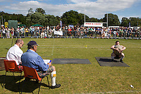 A man competes in a stone lifting competition at the Helensburgh and Lomond Highland Games in Argyll.