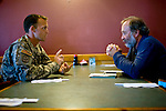 Time contributor Joe Kelin talks post-deployment challenges with CPT Jeremiah R. Ellis and 1SG Jack Robison of Dco, 1-12 IN, 4th BDE, 4th ID over sushi near the soldiers' post at Fort Carson in Colorado Springs, Colo.  Ellis and Robison are currently developing an experiental education program aimed at helping reintegrate soldiers following stressful deployments in war zones abroad.