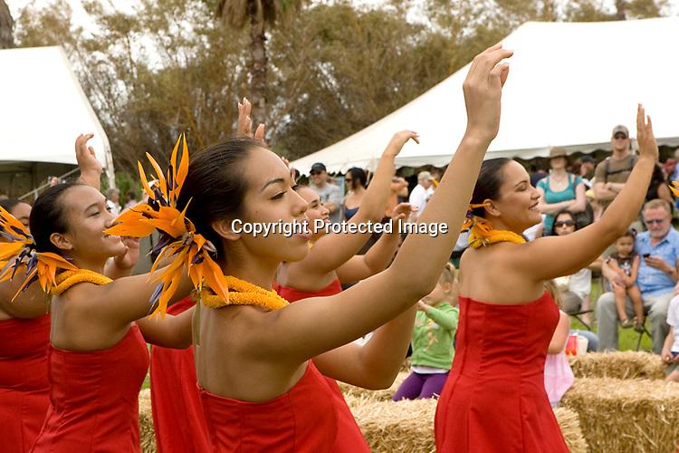 "Hulali Brown (center) dancing with ""halau Kekuaokala'au'ala'iliahi"" from Wailuku at the Ag Festival Sat Ap. 3rd held at the Maui Tropical Plantation."
