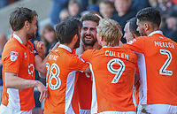 Blackpool's Clark Robertson is mobbed by teammates Kelvin Mellor, Mark Cullen, Jack Payne and Andy Taylor after scoring his side's second goal<br /> <br /> Photographer Alex Dodd/CameraSport<br /> <br /> The EFL Sky Bet League Two - Blackpool v Cheltenham Town - Saturday 22nd April 2017 - Bloomfield Road - Blackpool<br /> <br /> World Copyright &copy; 2017 CameraSport. All rights reserved. 43 Linden Ave. Countesthorpe. Leicester. England. LE8 5PG - Tel: +44 (0) 116 277 4147 - admin@camerasport.com - www.camerasport.com
