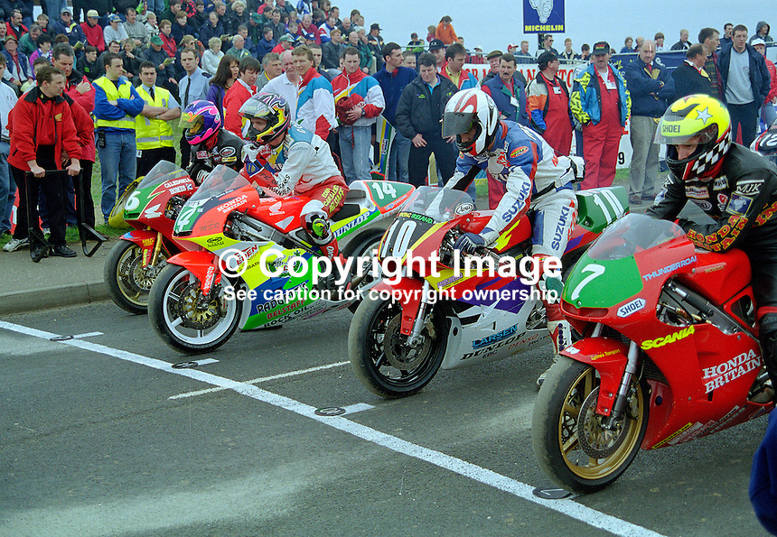 Riders on the grid at the start of one of the races at the 1998 NW200 motorcycle event. Ref: 199805018...Copyright Image from Victor Patterson, 54 Dorchester Park, Belfast, UK, BT9 6RJ..Tel: +44 28 9066 1296.Mob: +44 7802 353836.Voicemail +44 20 8816 7153.Skype: victorpattersonbelfast.Email: victorpatterson@mac.com.Email: victorpatterson@ireland.com (back-up)..IMPORTANT: If you wish to use this image or any other of my images please go to www.victorpatterson.com and click on the Terms & Conditions. Then contact me by email or phone with the reference number(s) of the image(s) concerned.