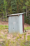 Corrugated metal outhouse at the Midwest Mine in the Creede Mining District in the San Juan Mts. of Colorado