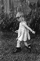 She found a pair of boots, way larger that her feet. I took this photo as she was walking outside of the barn.