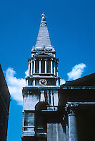 "Nicholas Hawksmoor: St. George, Bloomsbury. Tower is a square topped by  ""a paraphrase of the Museum of Halicarnassus"" and a statue of George I. Photo '90."