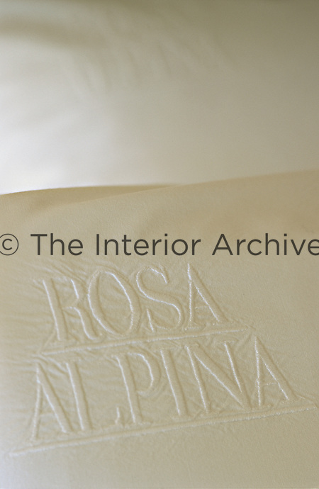 A detail of the embroided bed linen at the Hotel & Spa Rosa Alpina in the Dolomites