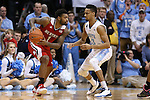 24 February 2015: NC State's Trevor Lacey (1) and North Carolina's J.P. Tokoto (13). The University of North Carolina Tar Heels played the North Carolina State University Wolfpack in an NCAA Division I Men's basketball game at the Dean E. Smith Center in Chapel Hill, North Carolina. NC State won the game 58-46.
