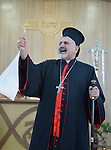 Syriac Catholic Patriarch Ignace Joseph III Younan speaks during a Mass in a displaced persons camp in Ankawa, near Erbil, Iraq, on April 11, 2016. The Mass concluded a three day visit by Cardinal Timothy Dolan, archbishop of New York and chair of the Catholic Near East Welfare Association, to Iraqi Kurdistan with other church leaders to visit with Christians and others displaced by ISIS.