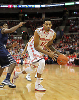 Ohio State's LaQuinton Ross (10) looks to pass the ball during the first half against against North Florida, Friday, Nov. 29, 2013, in Columbus, Ohio. (Photo by Terry Gilliam)