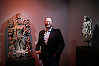 Nayef Homsi poses next to pieces of art of his collection during the Asian Art Week in New York. 11.03.2015. Eduardo MunozAlvarez/VIEWpress.