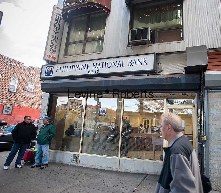 """A branch of the Philippine National Bank on Roosevelt Avenue in Queens in New York in the """"Little Manila"""" neighborhood on Friday, November 8, 2013. Super Typhoon Haiyan, which meteorologists think might be the strongest storm ever recorded, has hit the Philippines with fatalities and massive property destruction. The storm has sustained winds of 195 mph (315 kph) and approximately 125,000 people evacuated.  Fifteen percent, about 13,000 people, are of Filipino background and live in Woodside. (© Richard B. Levine)"""