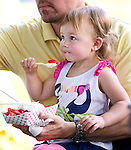 Southbury, CT- 14 June 2015-061415CM04- CL ONLY PLEASE Maeve Bassett, 2, and her dad, Bill Bassett of Easton enjoy strawberry shortcake during the annual  Southbury Strawberry Festival at the United Church of Christ in Southbury on Sunday.  The event featured homemade strawberry shortcake, chocolate-covered strawberries, barbecued food, activities for children, pony rides, live music and dancing.  Christopher Massa Republican-American