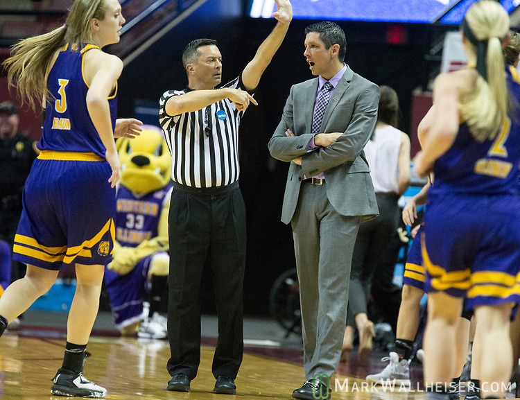 Western Illinois  head coach JD Gravina  calls a time out late in the second half of a first-round game against Florida State in an NCAA women's college basketball tournament in Tallahassee, Fla., Friday, March 17, 2017. Florida State defeated Westeren Illinois 87-66. (AP Photo/Mark Wallheiser)