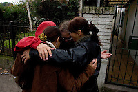 South America, Argentina, Almirante Brown, Adrogue, Evangelism - International missionaries along with locals say a prayer before they begin evangelizing on the streets of Adrogue, July 2006, &copy;Stephen Blake Farrington<br />