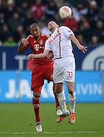 FUSSBALL   1. BUNDESLIGA  SAISON 2012/2013   16. Spieltag FC Augsburg - FC Bayern Muenchen         08.12.2012 Jerome Boateng (li, FC Bayern Muenchen) gegen Sascha Moelders (FC Augsburg)