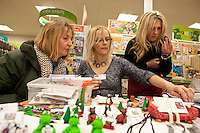 Sally Shuttleworth (left) and Jessica Slat (right) find out how to model with polymer clay from demonstarator Gill Cosford
