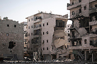 In this Sunday, Dec. 02, 2012 photo, destroyed buildings are seen along a desolated street in the Amarya district after several weeks of intense battles between rebel fighters and the Syrian army in Aleppo, the Syrian's largest city. (AP Photo/Narciso Contreras)