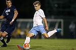06 October 2015: North Carolina's Alan Winn (18) and UNCW's Brayden Smith (14). The University of North Carolina Tar Heels hosted the University of North Carolina Wilmington Seahawks at Fetzer Field in Chapel Hill, NC in a 2015 NCAA Division I Men's Soccer match. North Carolina won the game 3-0.
