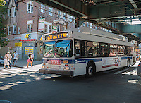 A bus travels under the elevated tracks of the Brighton Line of the New York subway system in the Brighton Beach neighborhood of Brooklyn in New York on Sunday, August 25, 2013. (© Richard B. Levine)
