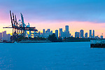 The cranes of the Port of Miami become part of the Miami skyline on Biscayne Bay.