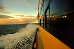 Sunrise onboard a Manly Sydney Ferry on this way to Circular Quay passing close by the Sydney Heads.