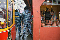 Moscow, Russia, 04/12/2011..Riot police stand between two kiosks as Russian opposition supporters demonstrate on Manezhnaya square outside the Kremlin calling for a boycott of the parliamentary elections.