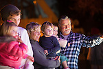 "The Sawyer family of Los Altos marvel at the ""Ferris Wheel"" float before the start of the Festival of Lights Parade."