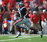 Mississippi running back Jeff Scott (3) looks back as he scores on a 55-yard pass play vs. Auburn at Vaught-Hemingway Stadium in Oxford, Miss. on Saturday, October 13, 2012. (AP Photo/Oxford Eagle, Bruce Newman)..