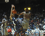 "Mississippi guard Zach Graham (32) passes as East Tennessee State's Curtis Wilkinson (45) and East Tennessee State's Isiah Brown (41) defend at the C.M. ""Tad"" Smith Coliseum in Oxford, Miss. on Saturday, December 18, 2010. Ole Miss won 71-50."