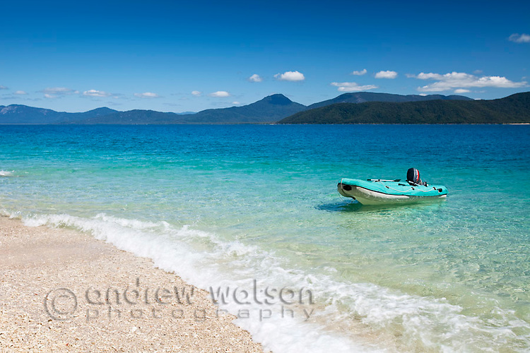 Zodiac floating in clear waters off Nudey Beach.  Fitzroy Island National Park, Cairns, Queensland, Austtralia