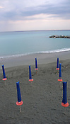 Umbrellas on the beach, Monterosso al Mare, Italy.
