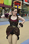NYC, New York, U.S.  21st May 2013.  Wearing old-fashioned dance clothes in Times Square, woman poses and hands out flyers to the Off-Broadway show 'Around the World' in 80 Days, during a pleasant spring day, with a high of 86ºF/32ºC, in Manhattan.