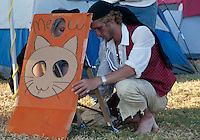 "A man in a pirate costume and a woman (Carina?) set up a ""Meow"" cardboard cutout at the Occupy Orange County - Irvine camp."