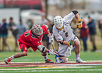 18 April 2015:  University of Vermont Catamount Face Off Specialist Luc LeBlanc, a Sophomore from Essex, VT, wins a face-off against the visiting University of Hartford Hawks at Virtue Field in Burlington, Vermont. The Cats defeated the Hawks 14-11 in the final home game of the 2015 season. Mandatory Credit: Ed Wolfstein Photo *** RAW (NEF) Image File Available ***