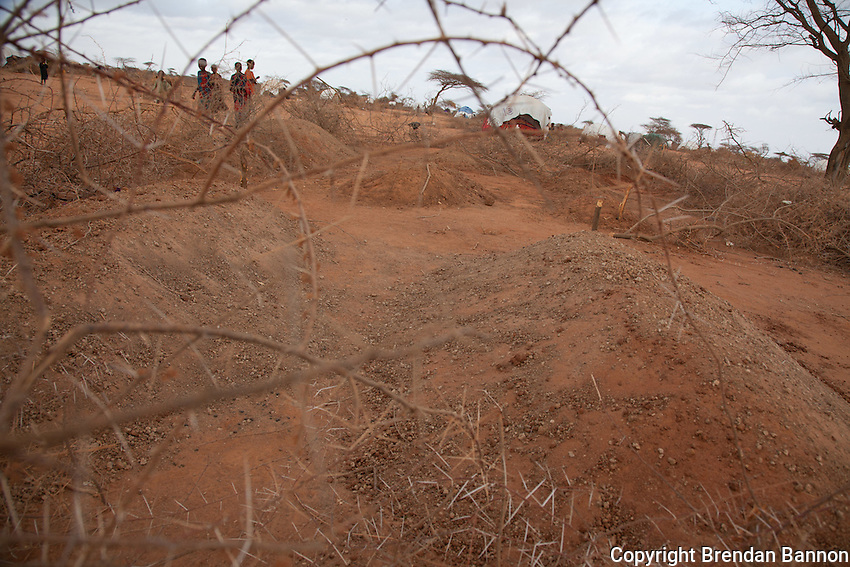 Fresh graves in Dagahaley, part of the sprawling Dadaab refugee camp. Thousands of Somali refugees have fled  to Kenya. Many arrive in the refugee camp exhausted and malnourished after a perilous journey out of draught and war torn Somalia. hundreds have died  in the camp as a consequences of malnutrition.