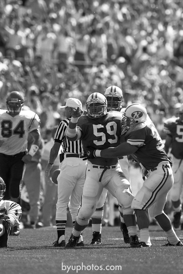 1305 D 11<br /> <br /> FTB 1305 A-T<br /> <br /> September 22, 1990<br /> <br /> Football - BYU vs. San Diego St.<br /> <br /> Mark Philbrick A-K <br /> Rick Gleason L-T<br /> <br /> BYU Photo 2017<br /> All Rights Reserved<br /> photo@byu.edu <br /> (801) 422-7322