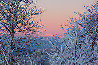 A brilliant pink sunset on a snowy day near Beech Mountain, NC.